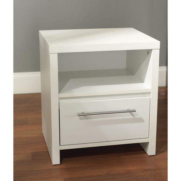 Match modern decors with this white nightstand from Simple Living. With its unfussy form, the nightstand lends clean lines and fresh style to bedrooms. Silver-toned hardware adds visual contrast. The