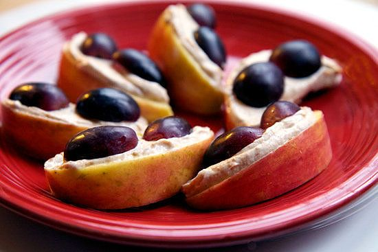 Low-Cal, Creamy Peanut Butter Spread: Replacing half of your peanut butter with Greek yogurt saves on calories and fat. Spread on toast, or make this simple 150-calorie snack shown; get the recipe for apples, grapes, and low-cal peanut butter spread here.
