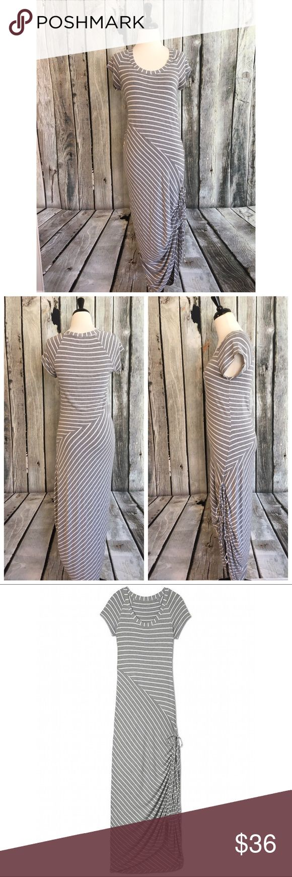 Athleta Dusky Shark Bite Gray Striped Ruched Dress Athleta Dusky Shark Bite dress in gray stripes with side hem ruching, women's M.   Bust across is 15 in, waist is 14.5 in and length is 57 in. Athleta Dresses Maxi