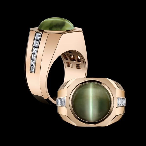 Robert Procop Exceptional Jewels - An Exceptional 21 carat Cat's Eye Ring. Cabochon cat's eye set in an architectural 18k rose gold mounting accented with inlaid square side diamonds. (=)