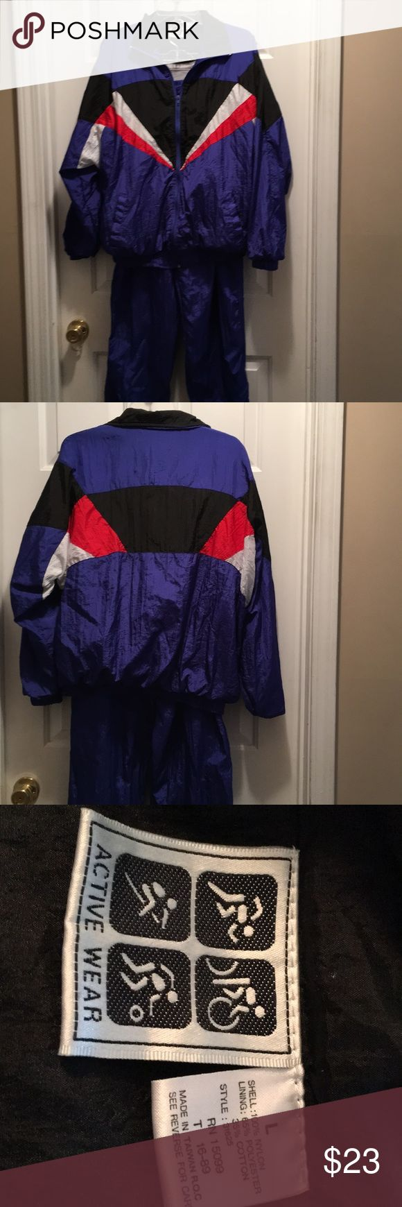 Active Wear Men's Jogging Suit Size L Men's Active Wear Jogging Suit done with Royal Blue accented with Red, White and Black.  Pockets are in the jacket as well as the pants.  It's a zippered front.  In great condition.  See photo number 4 where the tie is a little damaged. Active Wear Other