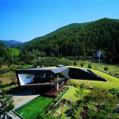 Villa Topoject: Location: Gyeonggi-do, South Korea Year of Construction: 2010 Architects: Architecture of Novel Differentiation (AND) This house gradually rises from the topography to form interior private spaces.