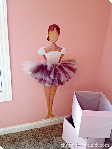 ballerina painted on the wall with a 3-D tutu sticking out from it - So cute for a girl's room!  But instead of a blank face, put an oval mirror so her own face looks back at her!!!