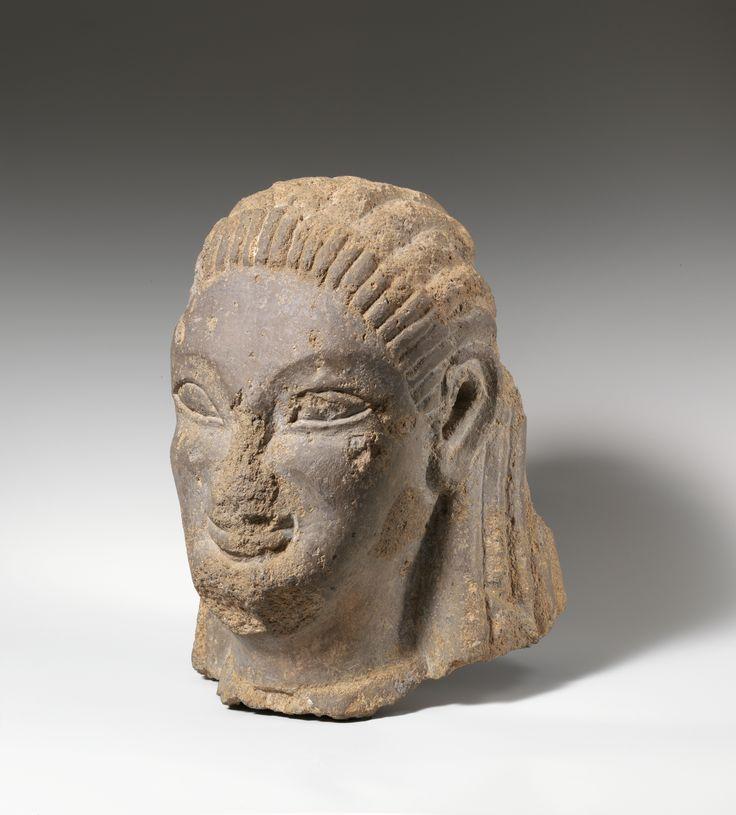 Tufa head of sphinx or siren ca b c etruscan