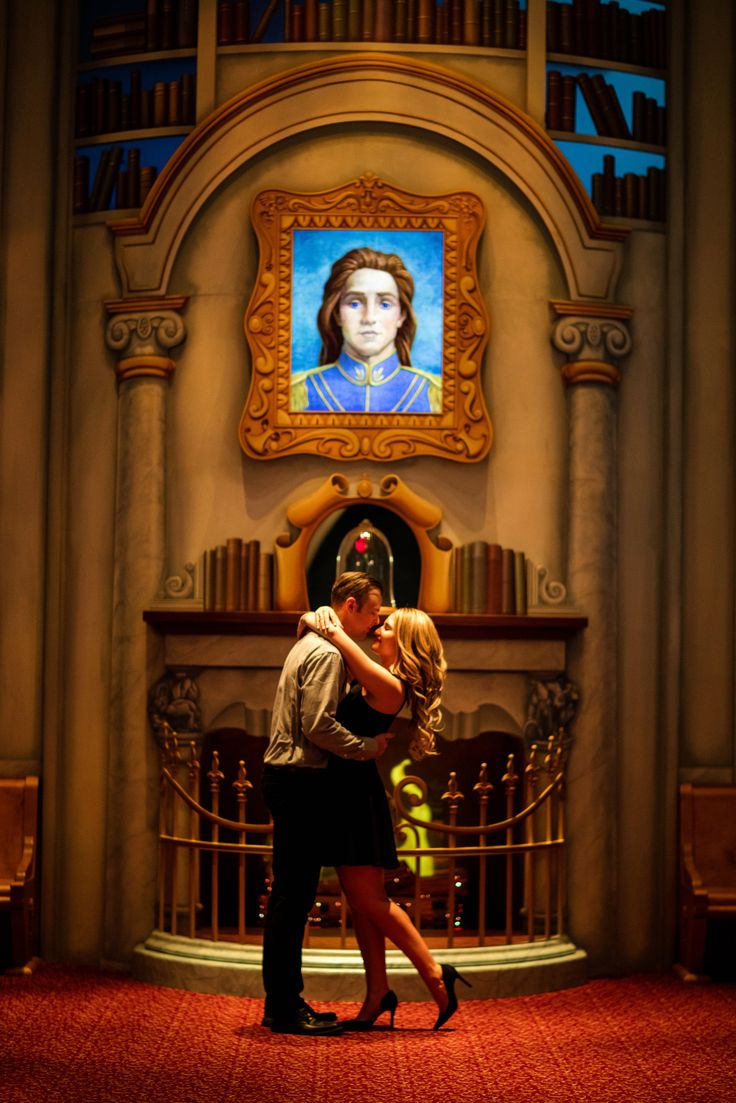 Jaime and Jason share a kiss in Beast's Library in the Animation Building in Disney California Adventure