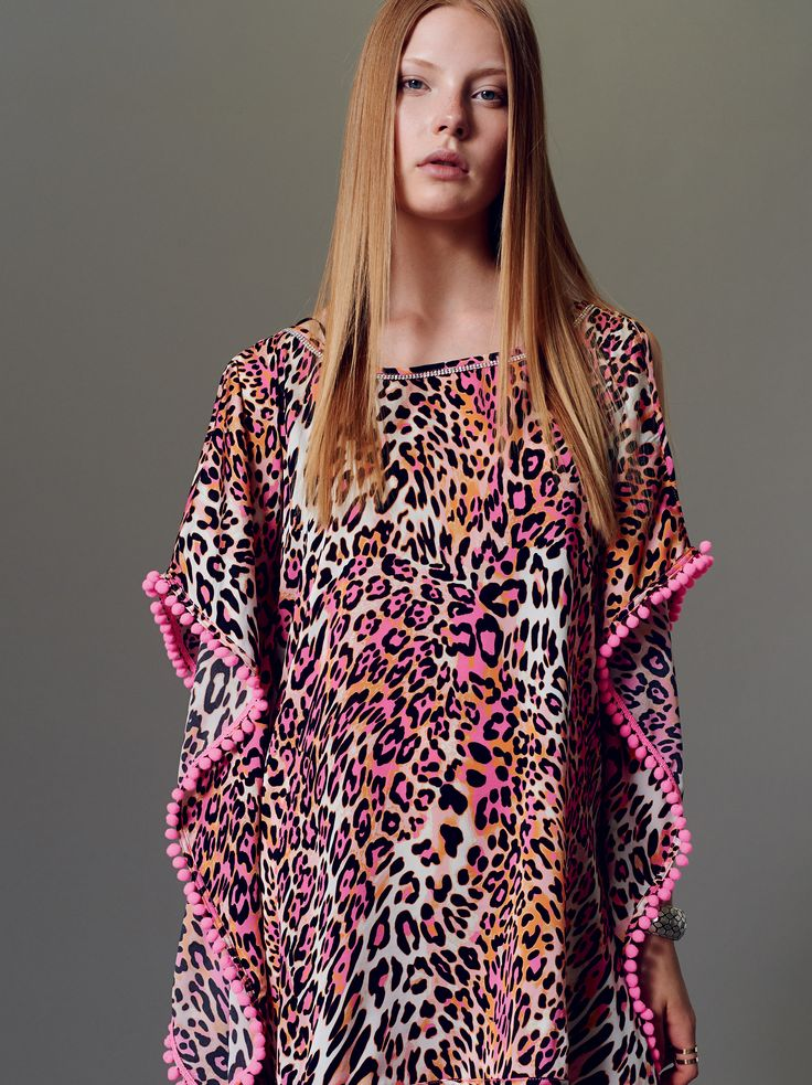 "Naughty Dog SS15 stretch silk caftan decorated with ""Leopard"" print and enriched with Swarovski crystals on the neckline."