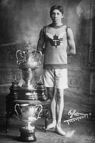 "Tom Longboat June 4 is officially ""Tom Longboat Day"" in Canada. He began racing in 1905, finishing second in the Victoria Day race at Caledonia, Ontario. In 1907 he won the Boston Marathon in a record time of 2:24:24 over the old 24-1/2 mile course, four minutes and 59 seconds faster than any of the previous ten winners of the event. In 1951 the Tom Longboat Awards were instituted by Jan Eisenhardt. This program, administered since 1999 by the Aboriginal Sport Circle,"