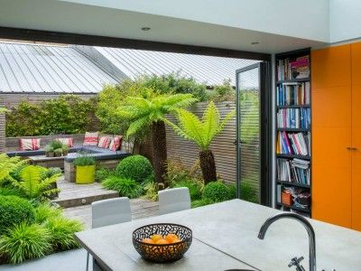 Oasis Garden Design native plants were used around the creek and pond they give the garden an authentic bushland look and feel and they attract native birds to the space Stunning Lush Garden Hidden Seating Area View From Kitchen
