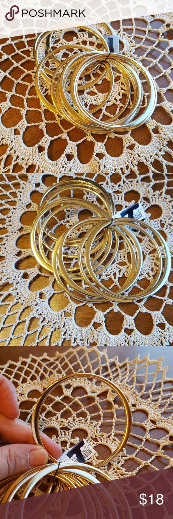 Chico's gold bangle bracelets NWT Chico's set of 10 bangle bracelets. Reflect beautifully, thicker in some spots, thinner in others.  A cut above the typical bangle! Price/brand partially blacked out on tag. Talbots Jewelry Bracelets