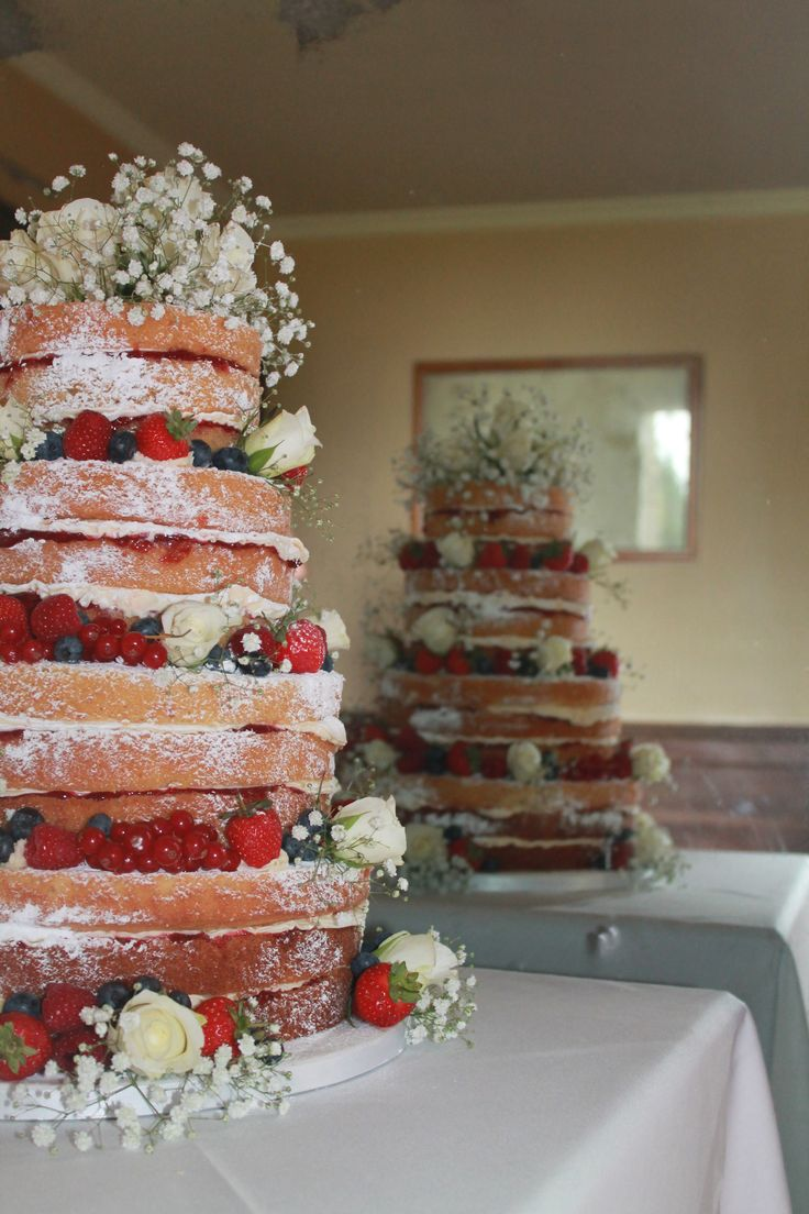 4 tier (triple layer) Victoria sponge Wedding cake or this but 2 tier and no flowers just strawberries, blueberries and raspberries
