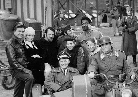 "Hogan Heros -- American television sitcom that ran from September 17, 1965, to April 4, 1971 Colonel Robert E. Hogan (Bob Crane); James a.k.a. Ivan, ""Kinch"" Kinchloe (Ivan Dixon); Technical Sergeant Andrew J. Carter (Larry Hovis); Corporal Louis 'Louie' LeBeau was a Master chef (Robert Clary); Corporal Peter Newkirk (Richard Dawson); Colonel Wilhelm Klink (Werner Klemperer); Hans Georg Schultz, (John Banner); Fräulein Hilda (Sigrid Valdis)"