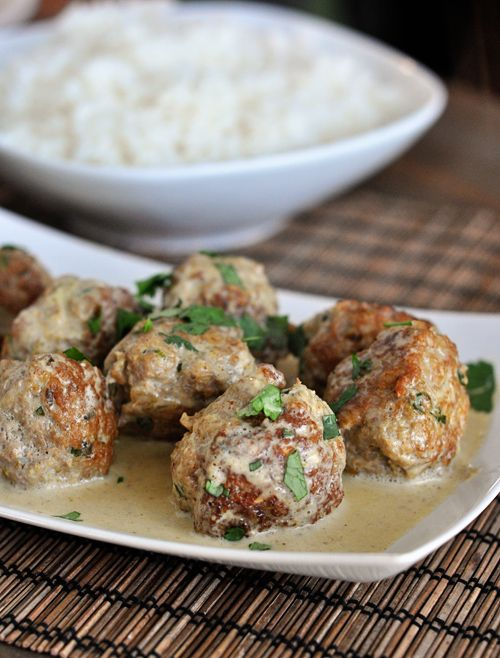 One-skillet homemade Thai Green Curry Meatballs -- yum! Use non-dairy milk (and skip the sugar) to make the creamy, spicy sauce.