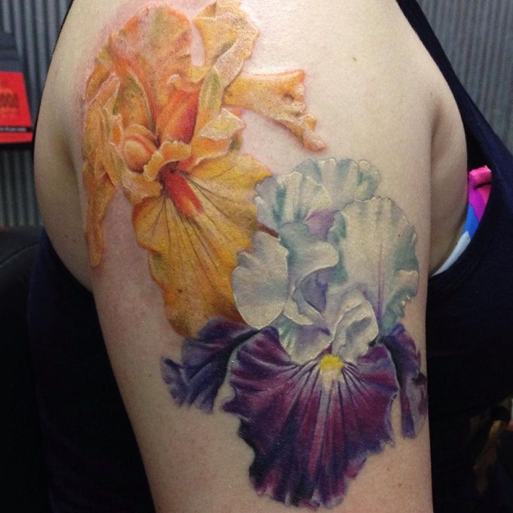 """""""Purple Iris is healed. Added the orange one - thanks Kristin for a fun project - foliage to come. @eternalink @neotatmachines #flowertattoo #iristattoo…"""""""