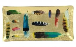 Try a southwestern piece of decor like this Feather Collection Tray made out of decoupaged glass.  A great gift that can be used for keys or display on a shelf! Just $35 from jaysonhome.com