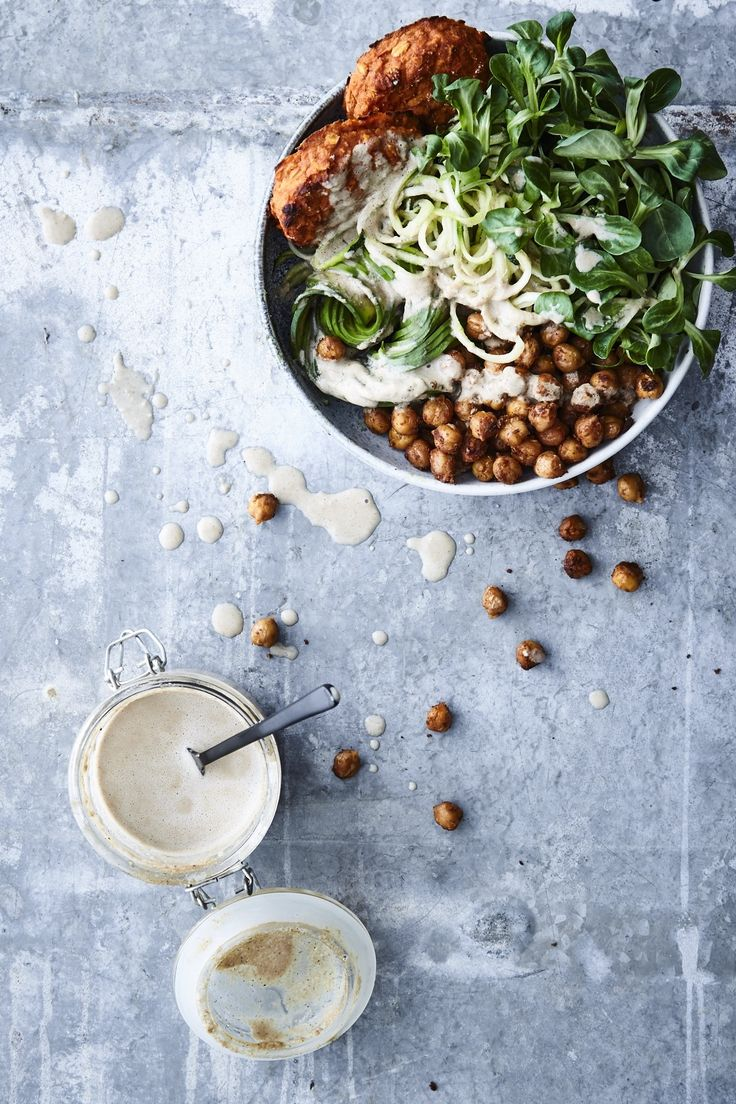 Buddha bowl with sweet potato patties, spicy chickpeas and tahini dressing