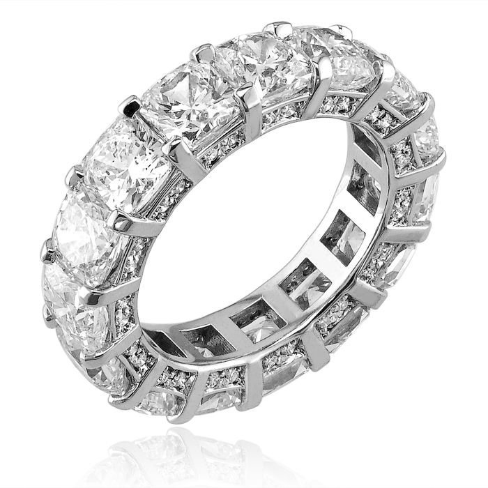 White Gold Shared Claw Eternity Ring Featuring Approximately Carat Average Radiant Cut Diamonds And Pav Set On The Facing