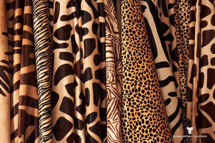 Rugs in your living room. hair on hides zebra, leopard, giraffe ...