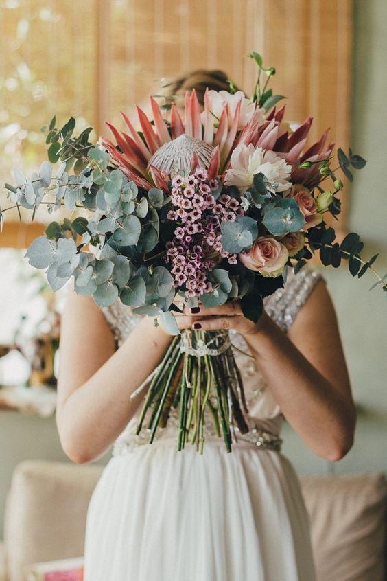 Protea bouquet for country wedding | iZO Photography | See more: http://theweddingplaybook.com/romantic-australian-bush-wedding/