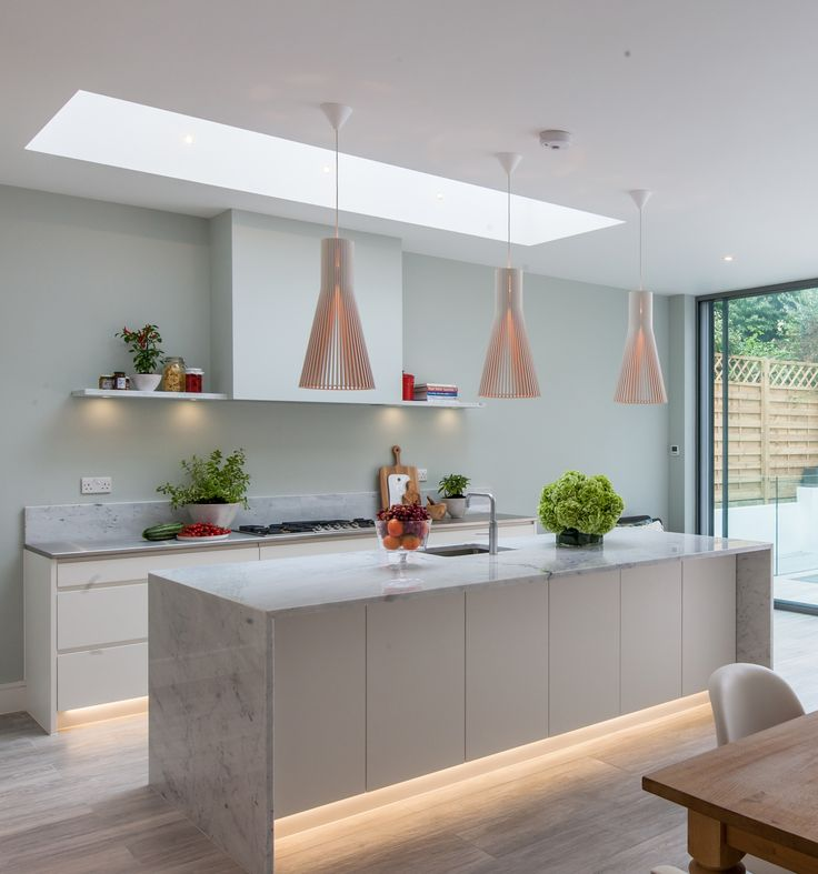 We love this sleek British kitchen with our Secto 4200 pendants above the kitchen island.