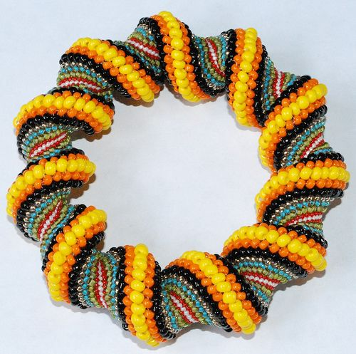 Multi Color Spiral Tubular Peyote Stitch Bracelet by pocketfuloftreasures, via Flickr - Spiral Peyote