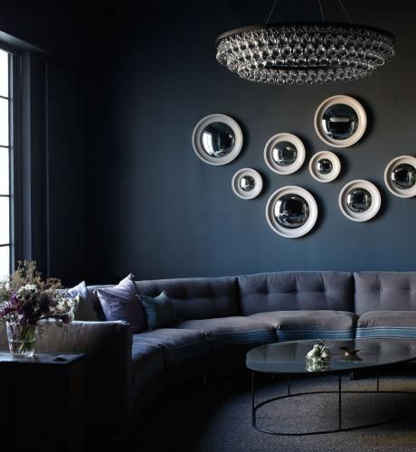 TRANSITION: All of the curved lines in this room lets your eyes travel. From the chandelier to the rounded sofa to the circular mirrors your eyes are moved.