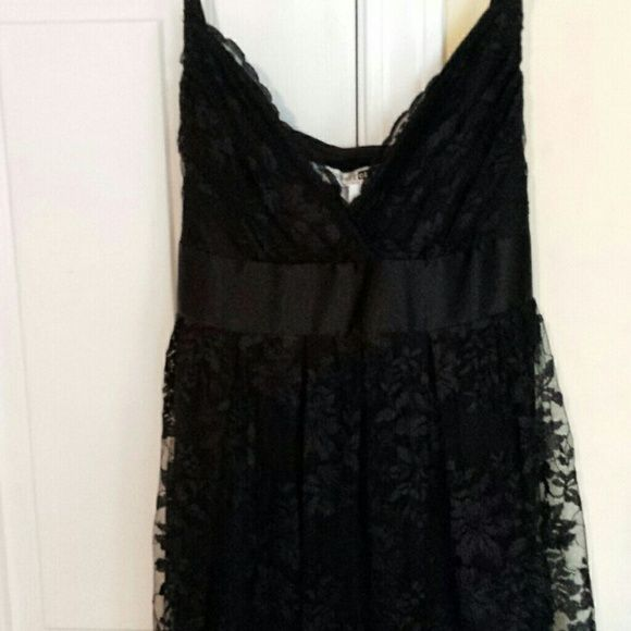 Lace overlay dress with satin tie Beautiful lace dress with satin tie around waist. Adjustable straps.  Nwot. Necessary Objects Dresses
