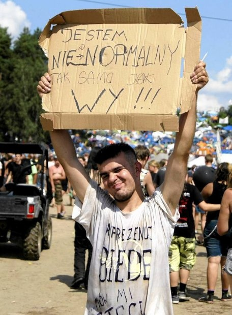 "Woodstock Festival Poland, 2012, the sign says: ""I am crazy and so are you"""