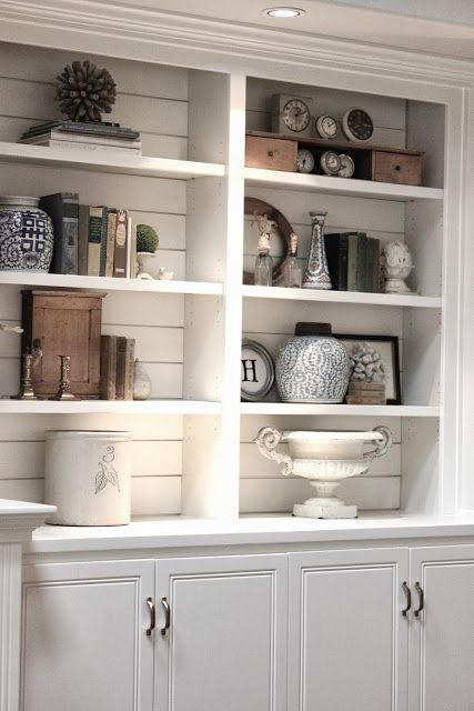 love the planked backboard of the bookcases