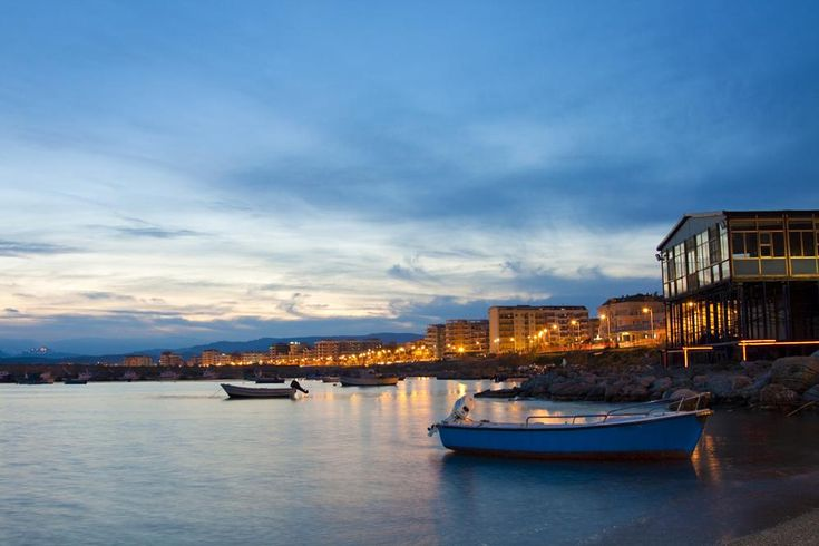 sunset over the harbor by danilo.assara