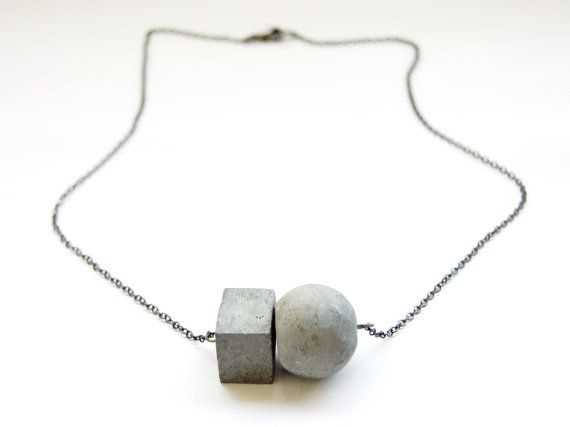 Circle meets square in a minimalist necklace featuring concrete beads.