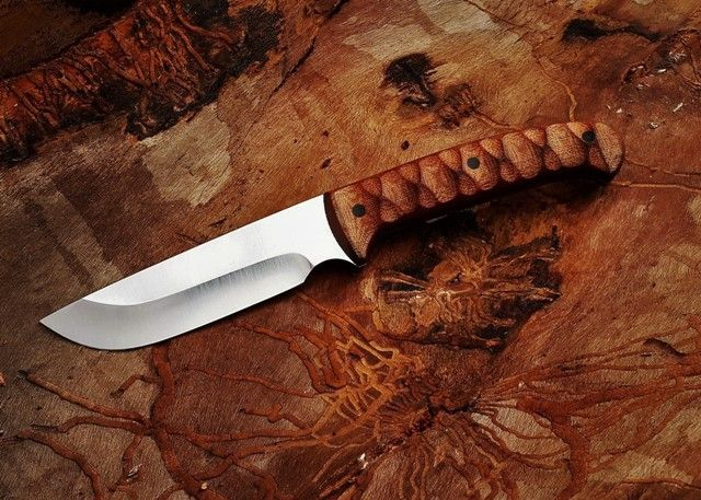 Hunting bushcraft knife by South African Knife maker Louis Naude. This knife on the picture is called the Jehu and it has a synthetic Canvas Micarta handle. It is available from Louis Naude knives (LEO Knives). Just waiting for your choice of handle material that includes a selection of African hardwoods and synthetic materials.  Louis Naude knives ships worldwide.