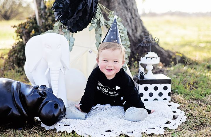 first birthday photo shoot monochrome kids party party animal theme wild thing party smash the cake toddler boy outfit
