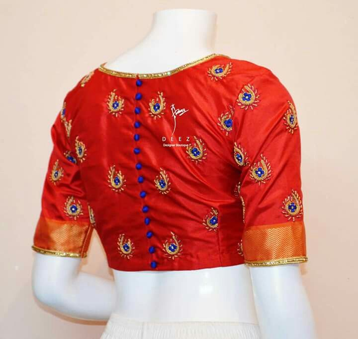 Red blouse with blue work