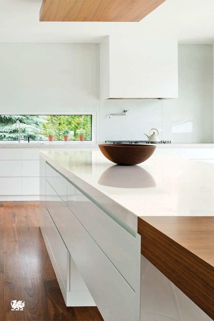 Modern cabinet lines and pristine edges are offset by our subtle, toffee swirled Dovedale™ design and hardwood flooring, making for a gorgeous galley-style kitchen and remodel.