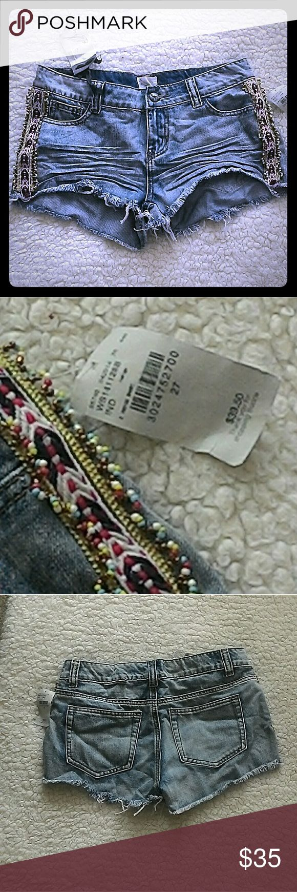 """NWT White Crow Shorts Cutest shorts on the planet! I bought them too big for me. Perfect for festivals with some cowboy boots.  The have beading and embroidered ribbon on the side of each leg. They have cute whiskers in the front.  85% cotton and 15% polyester. Not stretchy.  I'd say they're true to size. Waist measures 28"""" laid flat, from the back. Rise is 8"""", and inseam is 1"""".  I bought these at the Buckle store at the Irvine Spectrum. Crazy cute shorts! Please...no lowball offers. White…"""