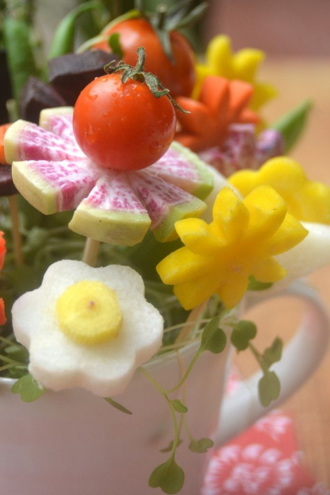 How to Make Edible Bouquets ~ Edible bouquets of veggies disguised as colorful blossoms can stand in for flowers on your summer table, and they're a great idea for barbecues and out door entertaining.