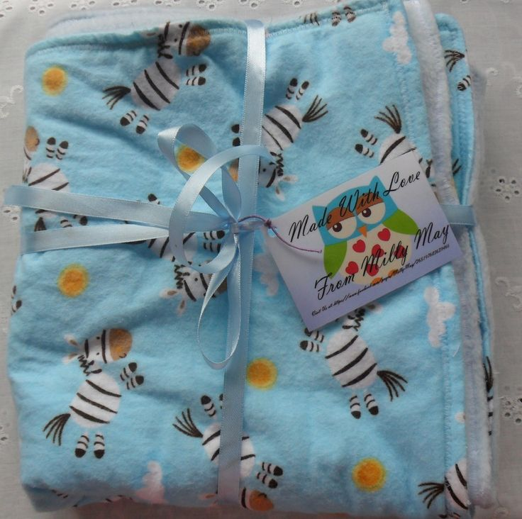Beautiful boys fleecy blanket. Flanelette facing with lovely zebra pattern and a non pill fleece backing.Perfect size for a pram or crib.Blanket measures 102cm x 56cm