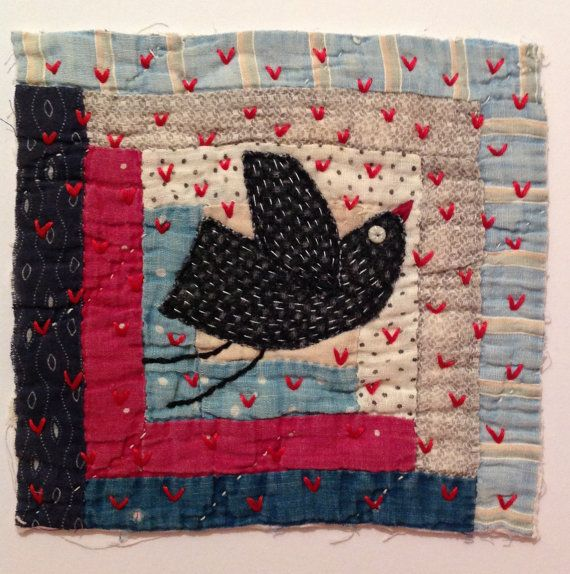 Bird and stars. Textile / fibre / fiber wall art collage. Original appliqué and embroidery on antique crazy patchwork quilt