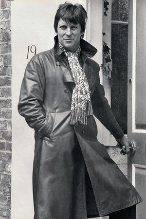 Jeremy Brett in an Aquascutum trenchcoat and green and red scarf, 1975