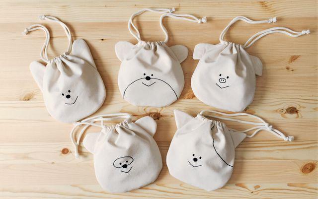 耳のついた可愛らしいキャラクターたちの巾着。 ちょっとした小物入れに、ポーチがわりに、お菓子を入れて持ち歩くのもおすすめです。 #minne本日のおすすめ