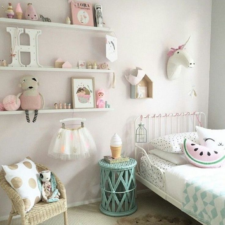 Pretty pink, white and mint girls room with the cutest little decorations.