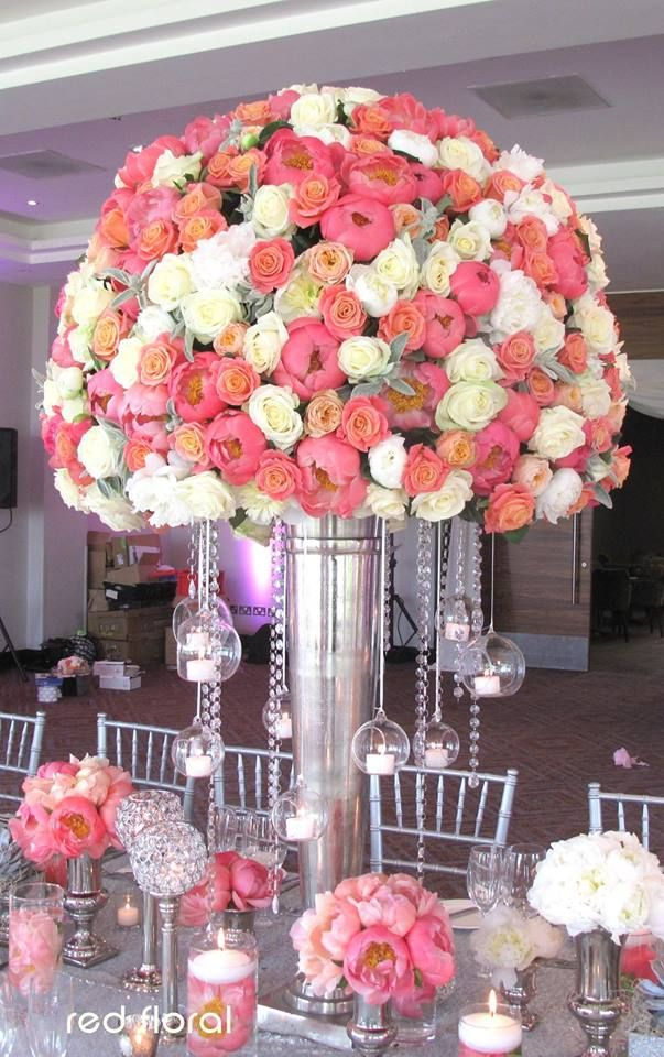 Gorgeous centerpieces at this pink uplighting wedding