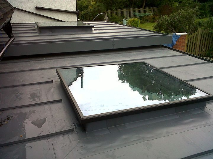 Single ply membrane roof with flat roof light. A little uninspiring but cost effective.