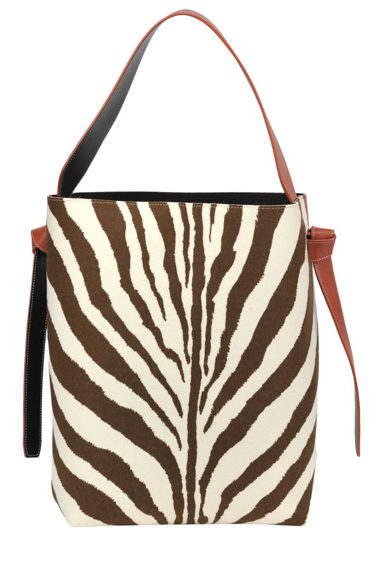 Buy Céline Bags on glamest.com Fashion Outlet, select the Céline Animal print cloth and leather bucket bag of your choice up to 40% off.