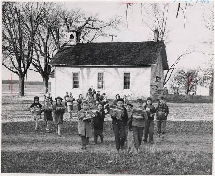 """First and second grade pupils in 1950 carry school supplies from their old one-room school house in Riley Township [Ohio] across the field to a new school."" ~ Children's games of the time: http://www.oneroomschoolhouses.ca/the-games-they-played.html More games: http://thelibrary.org/lochist/periodicals/bittersweet/fa73l.htm:"
