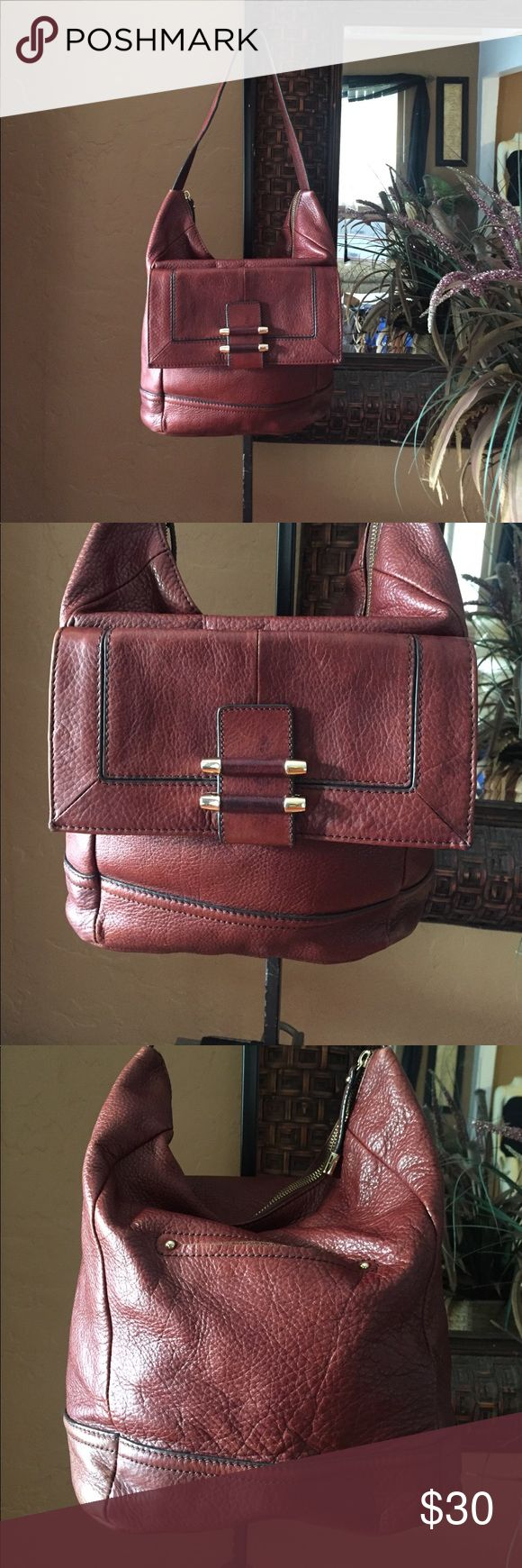 B Makowsky Handbag A brown in color leather handbag that measure about 11 inches from top to bottom and and about 14 inches from side to side and strap drop about 8 inches in good used condition. B Makowsky Bags Shoulder Bags