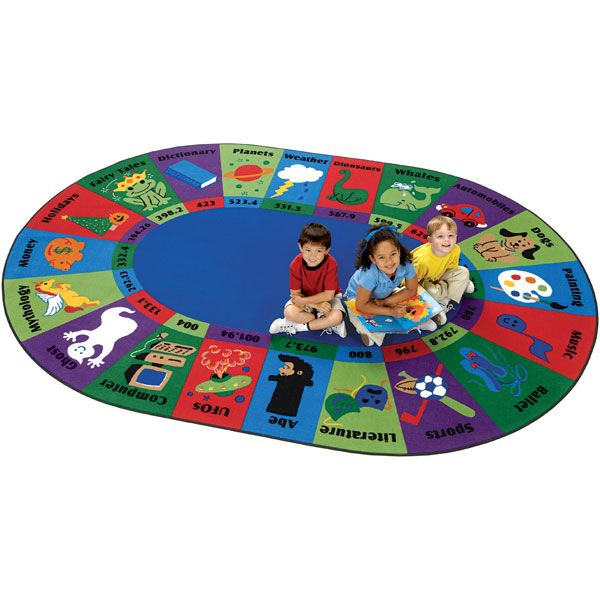 The Dewey Decimal Classroom Rug introduces library organization in a kid-friendly format. Colorful graphics represent the different topics that children can learn about in their library. Carpets for Kids' eco-friendly school rug is constructed of nylon fiber, which allows it to be easily recycled.