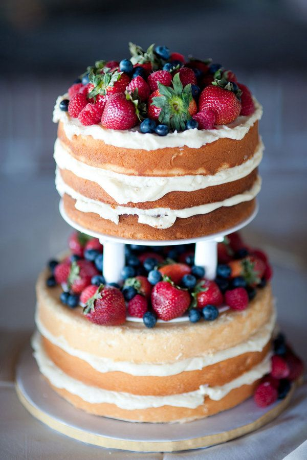 This bride and groom chose a simple two-tier pound cake filled with lemon custard frosting and topped with fresh strawberries, raspberries, and blueberries—perfect for a summer wedding!  SouthernWeddings.com: Charleston Wedding