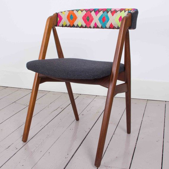 SALE PRICE REDUCED FROM £325 We have taken beautiful 1960s Danish teak chairs and upholstered them with bright and bold Peruvian fabric. The seat