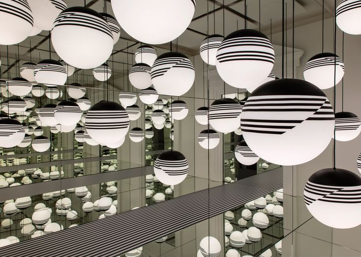 British designer Lee Broom's Opticality installation reflects lights into wall-to-wall infinity mirrors